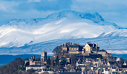 View in winter of Stirling castle sitting above the city with snow covered mountains (Stuc a Chroin and Ben Vorlich ) in the distance, Stirlingshire, Scotland, United Kingdom