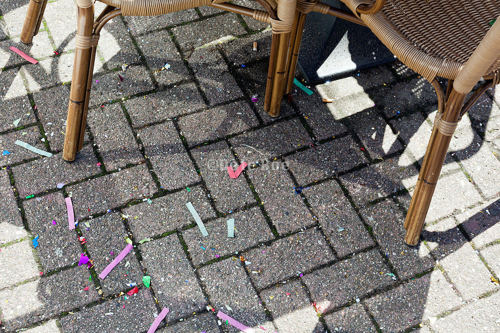 confetti on the ground by table