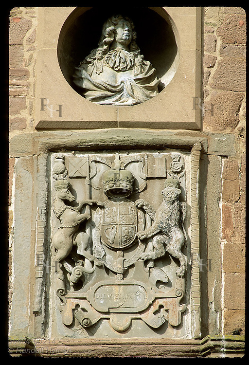 Strathmore royal coat of arms and bust of 3rd Earl sit above front door of Glamis Castle, Queen Mother's girlhood home; Scotland