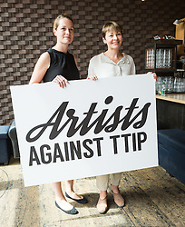 © Licensed to London News Pictures. 02/07/2015. London, UK. CARRIE CRACKNELL and CAROLINE LUCAS at an artists against Transatlantic Trade and Partnership (TTIP) photocall at the New Vic Theatre in London. The TTIP is a free trade and investment treaty currently being negotiated between the European Union and the USA. Photo credit : Vickie Flores/LNP