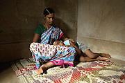 Sukanti Singh, 37, the mother of Budhia Singh, the famous Limca World Record marathoner, is holding her son in her arms in the house where they now live situated inside Salia Sahi slum (pop. 30.000) of Bhubaneswar, the capital of Orissa State, on Friday, May 16, 2008. On May 1, 2006, Budhia completed a record breaking 65 km run from Jagannath temple, Puri to Bhubaneswar. He was accompanied by his coach Biranchi Das and by the Central Reserve Police Force (CRPF). On 8th May 2006, a Government statement had ordered that he stopped running. The announcement came after doctors found the boy had high blood pressure and cardiological stress. As of 13th August 2007 Budhia's coach Biranchi Das was arrested by Indian police on suspicion of torture. Singh has accused his coach of beating him and withholding food. Das says Singh's family are making up charges as a result of a few petty rows. On April 13, Biranchi Das was shot dead in Bhubaneswar, in what is believed to be an event unconnected with Budhia, although the police is investigating the case and has made an arrest, a local goon named Raja Archary, which is now in police custody. **Italy and China Out**