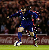 Photo: Jed Wee.<br />Middlesbrough v Manchester Utd. The Barclays Premiership. 29/10/2005.<br /><br />Manchester United's Wayne Rooney tries to get away from Middlesbrough's George Boateng.