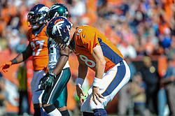 Sep 29, 2013; Denver, CO, USA; Denver Broncos quarterback Peyton Manning (18) reacts to an incomplete pass during the game against the Philadelphia Eagles at Sports Authority Field at Mile High. Mandatory Credit: John Geliebter-Philadelphia Eagles