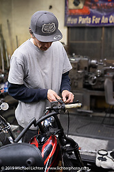 Masa Sugihara in his Luck Motorcycles shop in Kyoto where he specializes in long and skinny Harley-Davidson choppers. Japan. Thursday, December 6, 2018. Photography ©2018 Michael Lichter.