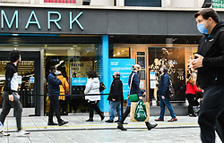 © Licensed to London News Pictures. 23/10/2020. Cardiff, UK. Shoppers pass a Primark store in the city centre of Cardiff on the day that the Welsh Goverment's seventeen-day-long, 'Firebreak Lockdown' comes into action to try and control the spread of coronavirus across Wales. Photo credit: Robert Melen/LNP