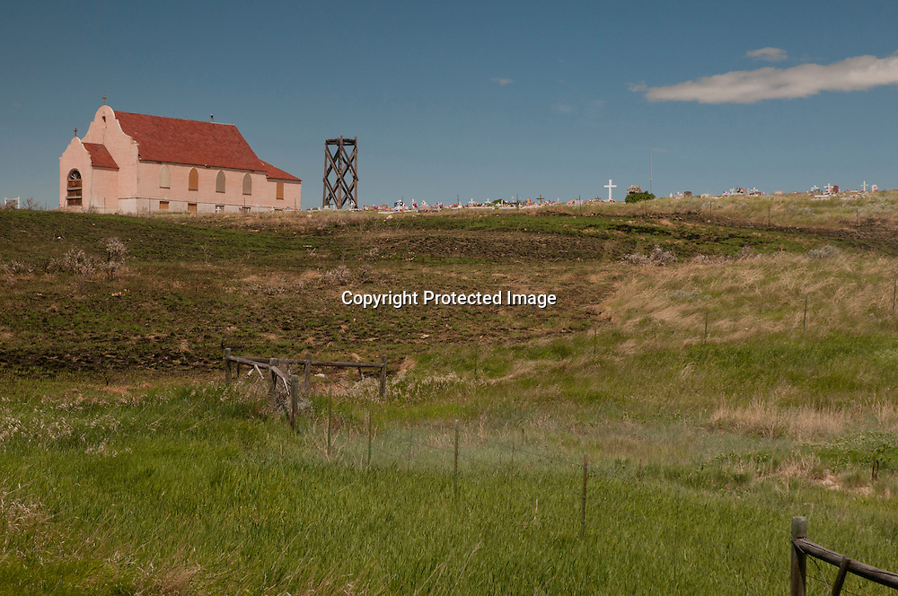 An old church and graveyard on the Ft. Belknap Indian Reservation along Route 2 on Montana's hi-line in the high plains of northern Montana.