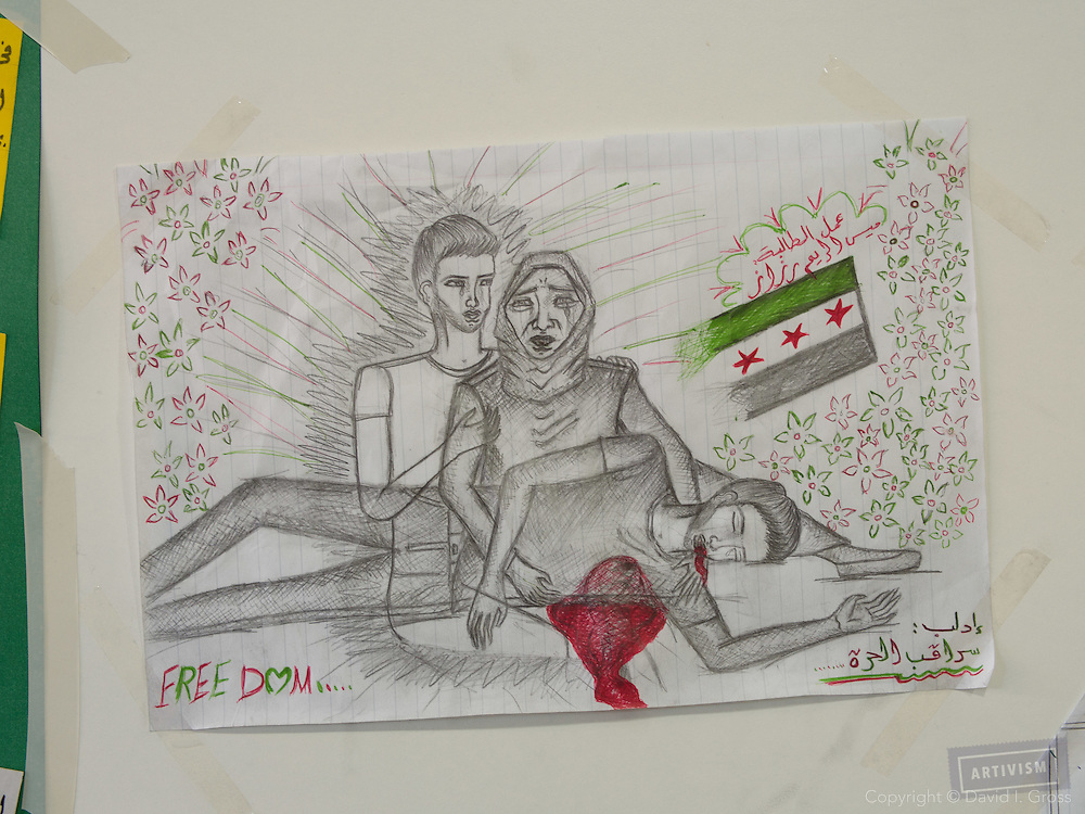 Drawings posted in the main hallway of the Free Syrian School in Reyhanli, Turkey
