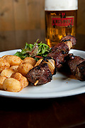 Baked mini potatoes, lamb skewer and a glass of cold beer