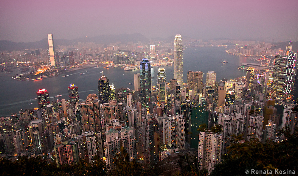 An evening view of Central Hong Kong from Victoria Peak and Kowloon across Victoria Harbor. Hong Kong is one of the most populated areas in the world.