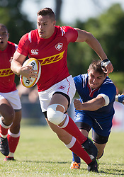 June 16, 2018 - Ottawa, ON, U.S. - OTTAWA, ON - JUNE 16: Cole Davis (11 Wing ) of Canada runs away from a Russian tackle in the Canada versus Russia international Rugby Union action on June 16, 2018, at Twin Elms Rugby Park in Ottawa, Canada. Russia won the game 43-20. (Photo by Sean Burges/Icon Sportswire) (Credit Image: © Sean Burges/Icon SMI via ZUMA Press)
