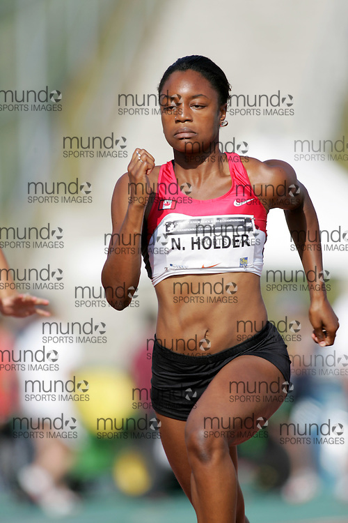 (Sherbrooke, Canada---21 July 2006) Nikkita Holder competing in the qualifying rounds of the 100m at the 2006 Canadian Junior Track and Field Championships 21-23 July 2006 held in Sherbrooke Quebec. Additional information can be found www.athletics.ca Copyright 2006 Sean Burges / Mundo Sport Images, www.mundosportimages.com