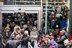 © Licensed to London News Pictures . 26/12/2013 . Manchester , UK . Security hold back crowds as they push to get in to Next in Manchester's Arndale Centre . Queues for Next in Manchester's Arndale Centre stretch around the block , ahead of a 6am opening . Thousands of shoppers queue for hours in freezing temperatures in Manchester this Boxing Day morning (26th December 2013) in order to be amongst the first to purchase reduced price products in shops' sales . Photo credit : Joel Goodman/LNP
