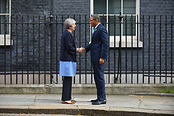 April 17, 2018 - London, England, United Kingdom - British Prime Minister Theresa May greets Jamaica's Prime Minister Andrew Holmes at 10 Downing Street, as sidelines of the Commonwealth Head of Government Meeting (CHOGM), London on April 17, 2018. (Credit Image: © Alberto Pezzali/NurPhoto via ZUMA Press)