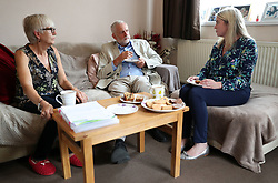 Labour leader Jeremy Corbyn and councillor Rachel Eden (right) speak to Carol Woolford about fuel poverty, at her home in Reading West.