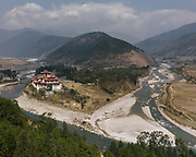 Aerial view on the famous Punakha Monastery, known as Dzong.<br /> The Dzong is located at the confluence of the Pho Chhu (father) and Mo Chhu (mother) rivers in the Punakha–Wangdue valley.