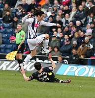Photo: Mark Stephenson.<br /> West Bromwich Albion v Birmingham City. Coca Cola Championship. 18/03/2007.Birmingham's Damien Johnson slids tacklels West Brom's Robert Koren