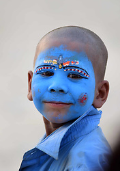 April 17, 2018 - Allahabad, Uttar Pradesh, India - Allahabad: A boy painted his face with color react to camera as he return after day long begging at Sangam in Allahabad on 17-04-2018. (Credit Image: © Prabhat Kumar Verma via ZUMA Wire)
