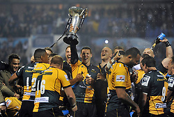 George North (Northampton) lifts the Amlin Challenge Cup trophy in celebration - Photo mandatory by-line: Patrick Khachfe/JMP - Tel: Mobile: 07966 386802 23/05/2014 - SPORT - RUGBY UNION - Cardiff Arms Park, Cardiff - Bath Rugby v Northampton Saints - Amlin Challenge Cup Final.