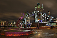 The statue and fountain of 'Girl with Dolphin' with Tower Bridge behind. London, United Kingdom