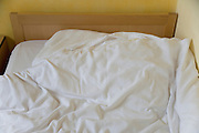 cushion and blanket of a ruffled bed