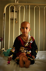 Nabila, 5, is treated for cancer at the Children's Hospital at the Pakistan Institute of Medical Sciences in Islamabad, Pakistan, Sept. 19, 2007.