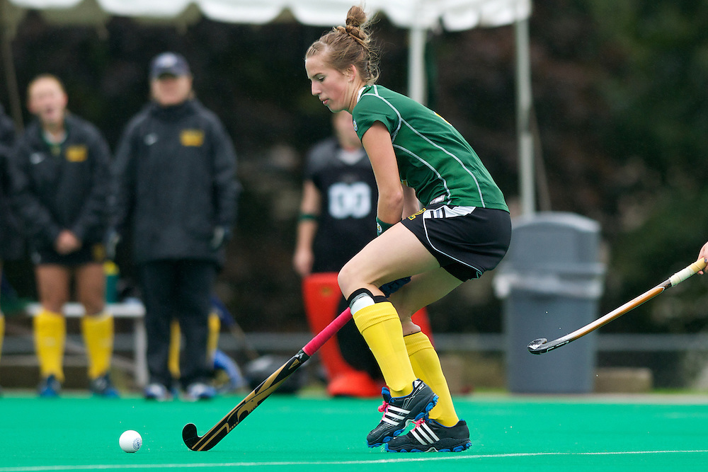 Catamounts midfielder Whitlee Burghardt (2) hits the ball during the women's field hockey game between the Maine Black Bears and the Vermont Catamounts at Moulton/Winder Field on Saturday afternoon September 29, 2012 in Burlington, Vermont.
