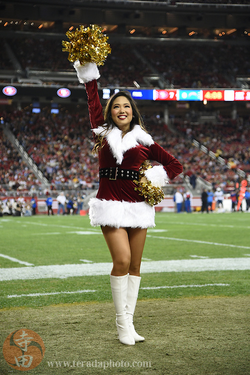 December 20, 2014; Santa Clara, CA, USA; San Francisco 49ers Gold Rush cheerleader Airi performs in a Santa outfit for Christmas during the first quarter against the San Diego Chargers at Levi's Stadium. The Chargers defeated the 49ers 38-35.