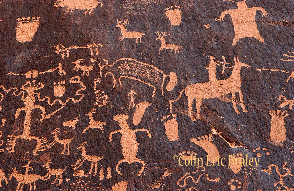 Newspaper Rock, located 28 miles northwest of Monticello, Utah, features petroglyphs etched in sandstone that records perhaps 2,000 years of human activity in the area. Etched into the desert varnish are symbols' representing the Fremont, Anasazi, and Navajo cultures.