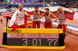 (From left to right) Poland's Karol Zalewski, Rafal Omelko, Lukasz Krawczuk and Jacob Krzewina celebrate setting a new world record by taking gold in 3:01:77 in the final of the Men's 4x400 metre relay during day four of the 2018 IAAF Indoor World Championships at The Arena Birmingham.