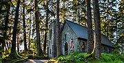 National Shrine of St. Therese, 22 miles north of downtown Juneau, in Tongass National Forest, Alaska, USA. A stone causeway from shore reaches this natural-stone chapel nestled amid a tranquil wooded island. This ministry of the Roman Catholic Diocese of Juneau is dedicated to St. Thérèse of Lisieux, the patron saint of Alaska, missionaries, and the Diocese of Juneau. She wrote that what really mattered in life was not our great deeds, but our great love. This image was stitched from multiple overlapping photos.