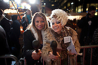 Two unidentified television reporters interact with a photographer at the 37th International Emmy Awards Gala in New York on Monday, November 23, 2009.  ***EXCLUSIVE***