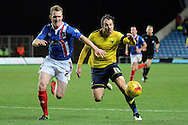 Oxford United striker Danny Hylton and Carlisle United defender Mark Ellis chase the ball during the Sky Bet League 2 match between Oxford United and Carlisle United at the Kassam Stadium, Oxford, England on 12 December 2015. Photo by Alan Franklin.