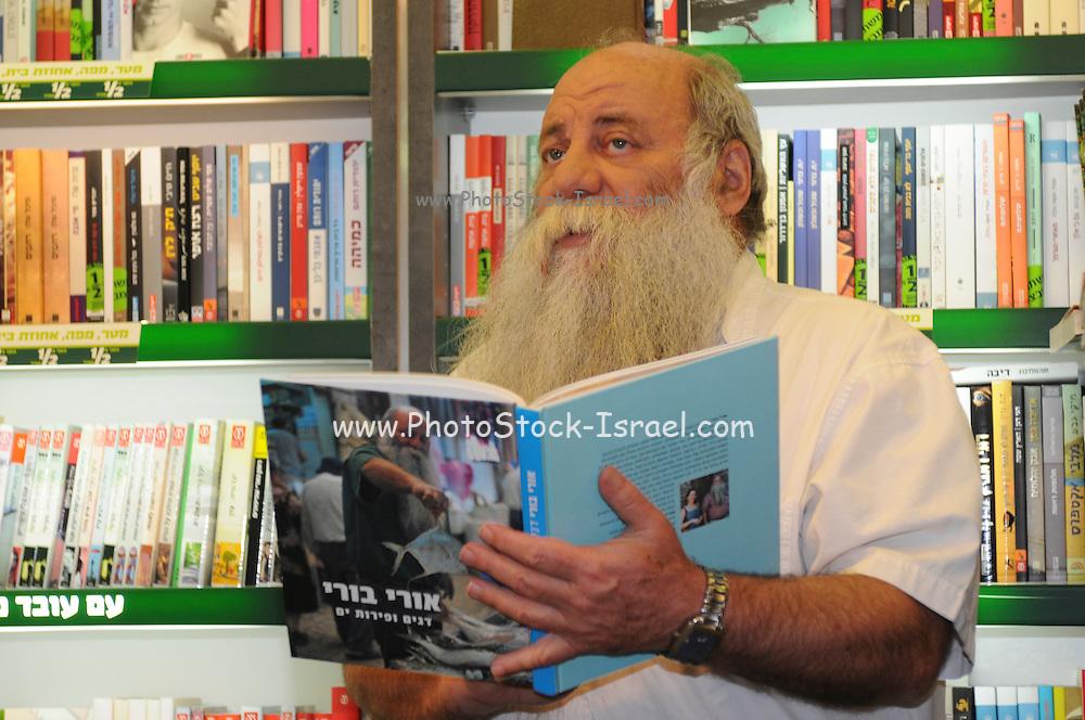 Uri Yarmias (AKA Uri Buri) an Israeli chef promotes his latest cookbook in a book store