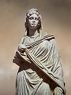 Roman statue of Sabina .Marble. Perge. 2nd century AD. Inv no 3066-3086. Antalya Archaeology Museum; Turkey. Against a warm art background. .<br /> <br /> If you prefer to buy from our ALAMY STOCK LIBRARY page at https://www.alamy.com/portfolio/paul-williams-funkystock/greco-roman-sculptures.html . Type -    Antalya     - into LOWER SEARCH WITHIN GALLERY box - Refine search by adding a subject, place, background colour, museum etc.<br /> <br /> Visit our ROMAN WORLD PHOTO COLLECTIONS for more photos to download or buy as wall art prints https://funkystock.photoshelter.com/gallery-collection/The-Romans-Art-Artefacts-Antiquities-Historic-Sites-Pictures-Images/C0000r2uLJJo9_s0