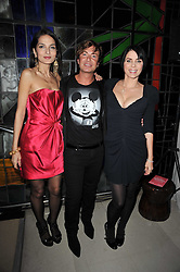 Left to right, YASMIN MILLS, JULIEN MACDONALD and SADIE FROST at the 2nd Rodial Beautiful Awards in aid of the Hoping Foundation held at The Sanderson Hotel, 50 Berners Street, London on 1st February 2011.