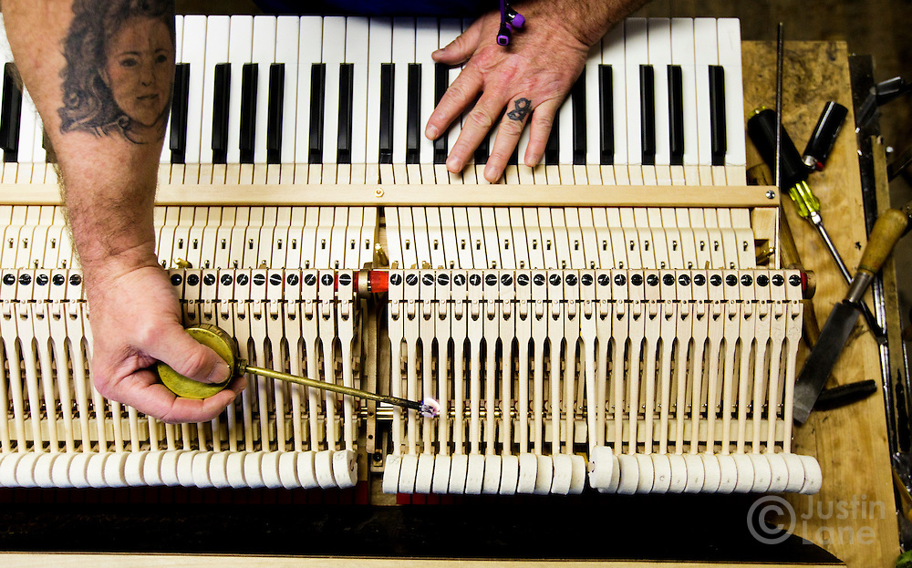 The hands of Dennis Schwiet make adjustments to the final regulation of piano keys, insuring the keys move freely and with proper spacing, at the Steinway and Sons piano production facility in Astoria, New York, USA, 04 April 2016. Each piano at the factory is built and assembled by hand, a process the company has been refining since being founded in 1853 in New York. In the late 1800s, there were hundreds of piano manufacturers in the United States, but Steinway and Sons is now one of only a few companies still making the instrument.