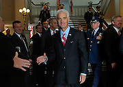Gov.-elect Charlie Crist, center, shakes hands with supporters before taking the stage for his inauguration Tuesday, Jan. 2, 2007 in Tallahassee, FL. Crist took office as governor along with Lt. Gov. Jeff Kottkamp. (AP Photo/Colin Hackley, POOL)