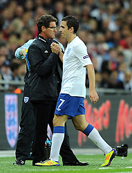 06.09.2011, Wembley Stadium, London, GBR, UEFA EURO 2012, Qualifikation, England vs Wales, im Bild England's Stewart Downing shakes hands with manager Fabio Capello after being substituted during the UEFA Euro 2012 Qualifying Group G match at Wembley Stadium on 6/9/2011. EXPA Pictures © 2011, PhotoCredit: EXPA/ Propaganda Photo/ Chris Brunskill +++++ ATTENTION - OUT OF ENGLAND/GBR+++++