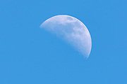 Daytime moon with a blue sky background