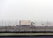 © Licensed to London News Pictures. 12/12/2012. Heathrow, UK Heavy fog hangs above Heathrow Airport today, 12 December 2012. Fog at Heathrow airport this morning. Heavy fog is causing flights to be delayed and disruption across the country.  Photo credit : Stephen Simpson/LNP