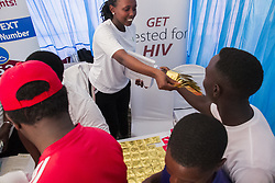 KIGALI, Dec. 1, 2019  A worker distributes condoms during the activities marking the World AIDS Day in Kigali, capital of Rwanda, on Dec. 1, 2019. Rwanda joined the rest of the world to mark the World AIDS Day with special car-free day activities in Kigali on Sunday. (Photo by Cyril Ndegeya/Xinhua) (Credit Image: © Cyril Ndegeya/Xinhua via ZUMA Wire)
