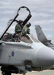 © under license to London News Pictures. 08/04/11 Prime Minister David Cameron is to look again at cuts to the defence budget. According to the reports, plans to scrap RAF Tornados and surveillance planes may be reversed. FILE PICTURE DATED 03/06/09. the crew of an RAF Tornado fighter bomber prepare to disembark after landing at RAF Marham in Norfolk. Credit should read Matt Cetti-Roberts/LNP