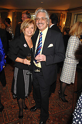 ELAINE PAIGE and LAURIE HOLLOWAY at a tribute lunch for Elaine Paige hosted by the Lady Taverners at The Dorchester, Park Lane, London on 13th November 2007.<br />
