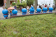 July 29, 2016, Tokyo, Japan: At the Roppongi Hills building complex in Tokyo, a summer festival called Summer Station is taking place from Jul. 16-Aug. 28. The main event of this festival is 66 life size Doraemon statues on display in an outdoor plaza called 66 Plaza. Doraemon is the lovable animation and manga character who is a robotic cat from 22nd century, sent to aid a pre-teen boy named Nobita. This Japanese creation was first introduced in 1969 as a manga series by the writing team Fujiko Fujio. To date 1,345 stories have been published by Shogakukan Inc. In 1979, Shin-Ei Animation studios began producing a TV series on Doraemon which ended in 2005 after 1787 episodes aired. The Doraemon media franchise is now owned by TV Asahi which has adapted the character into films, video games, a musical, and merchandising unit. Doraemon also has a large fan base outside Japan including mainland Asia, Europe and the USA where it's broadcast by the Boomerang TV network. The name Doraemon is play on words that means stray, as in a stray street cat. (Torin Boyd/Polaris).