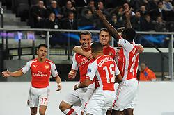 Arsenal's Lukas Podolski celebrates with his team mates after scoring. - Photo mandatory by-line: Dougie Allward/JMP - Mobile: 07966 386802 - 22/10/2014 - SPORT - Football - Anderlecht - Constant Vanden Stockstadion - R.S.C. Anderlecht v Arsenal - UEFA Champions League - Group D