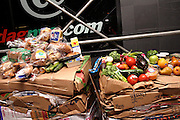 Part of the food recovered from one place only, during a Freegan trash tour to dump sites alond 3rd Avenue in Manhattan, New York, NY., on Wednesday, July 19, 2006..Freegans are a community of people who aims at recovering wasted food, books, clothing, office supplies and other items from the refuse of retail stores, frequently discarded in brand new condition. They recover goods not for profit, but to serve their own immediate needs and to share freely with others. According to a study by a USDA-commissioned study by Dr. Timothy Jones at the University of Arizona, half of all food in the United States is wasted at a cost of $100 billion dollars every year. Yet 4.4 million people in the United States alone are classified by the USDA as hungry. Global estimates place the annual rate of starvation deaths at well over 8 million. The massive waste generated in the process fills landfills and consumes land as new landfills are built. This waste stream also pollutes the environment, damages public health as landfills chemicals leak into the ground, and incinerators spew heavy metals back into the atmosphere. Freegans practice strategies for everyday living based on sharing resources, minimizing the detrimental impact of our consumption, and reducing and recovering waste and independence from the profit-driven economy. They are dismayed by the social and ecological costs of an economic model where only profit is valued, at the expense of the environment. In a society that worships competition and self-interest, Freegans advocate living ethical, free, and happy lives centred around community and the notion that a healthy society must function on interdependence. Freegans also believe that people have a right and responsibility to take back control of their time.