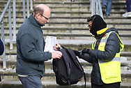 A steward wearing gloves searches a fans bag before the Premier League match at the Emirates Stadium, London. Picture date: 7th March 2020. Picture credit should read: Paul Terry/Sportimage