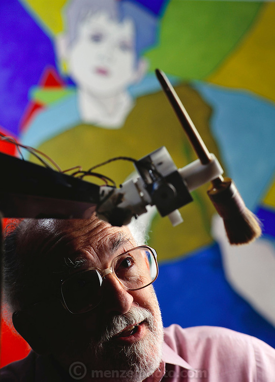 """Harold Cohen, former director of the Center for Research in Computing and the Arts (CRCA), is the author of the celebrated AARON program, an ongoing research effort in autonomous machine (art making) intelligence. Cohen is seen looking at his creation, a robot """"artist"""" that painted the picture in the background. California, USA"""
