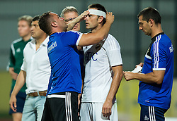 Injured Ostojic Bojan of FK Cukaricki during 1st Leg football match between NK Domzale (SLO) na FC Cukaricki (SRB) in 1st Round of Europe League 2015/2016 Qualifications, on July 2, 2015 in Sports park Domzale,  Slovenia. Photo by Vid Ponikvar / Sportida