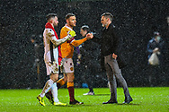 Motherwell FC manager Graham Alexander congratulates his players after the final whistle of the SPFL Premiership match between Motherwell and Dundee United at Fir Park, Motherwell, Scotland on 3 February 2021.